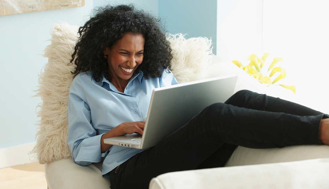 Member Benefits Woman Couch Computer