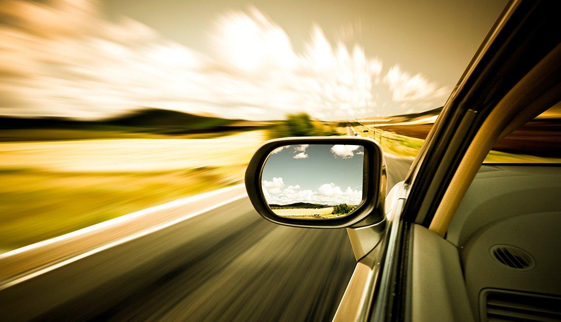 Car mirror at sunset