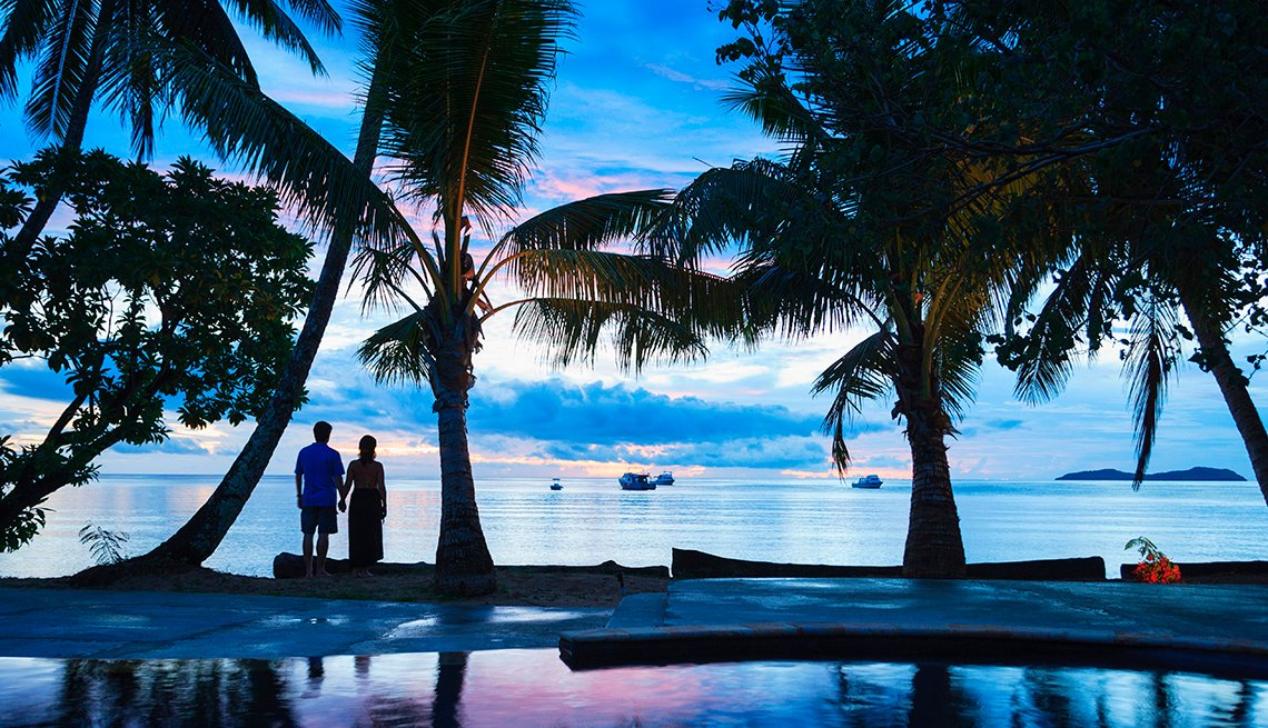 Couple Watching Sunset on Tropical Beach, AARP Marketing Poll December 2017