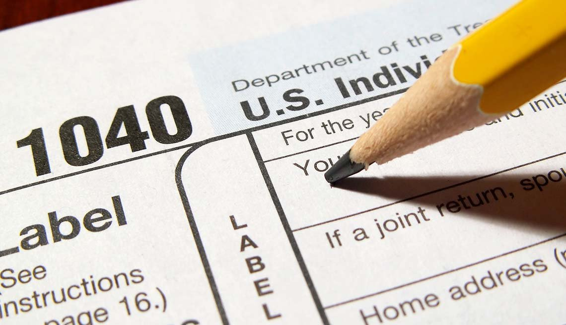 Pencil and 1040 tax form, AARP Foundation Tax-Aide