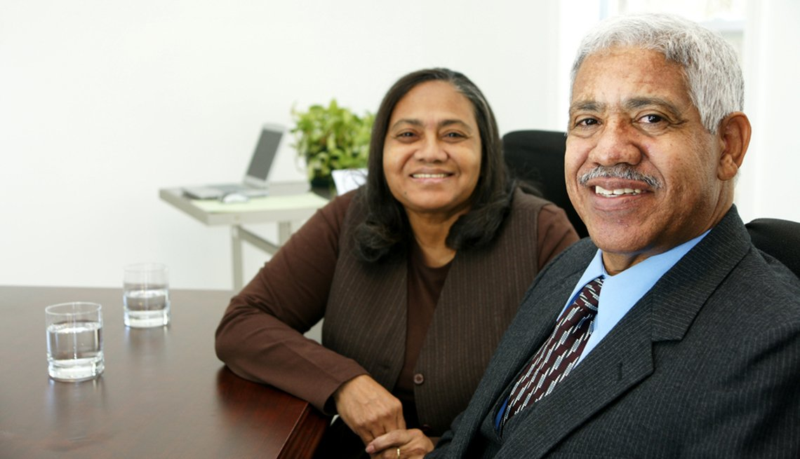 mature Latino man and woman, business meeting, AARP Foundation, Senior Community Service Employment Program