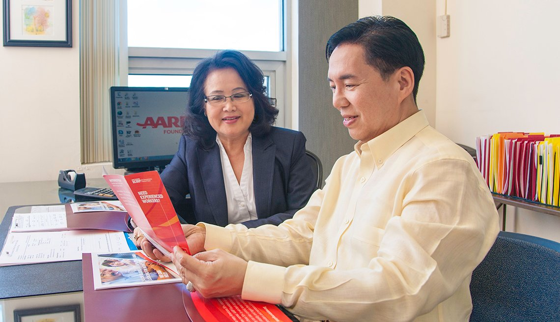 Asian man and woman, meeting in AARP office, AARP Foundation, Senior Community Service Employment Program