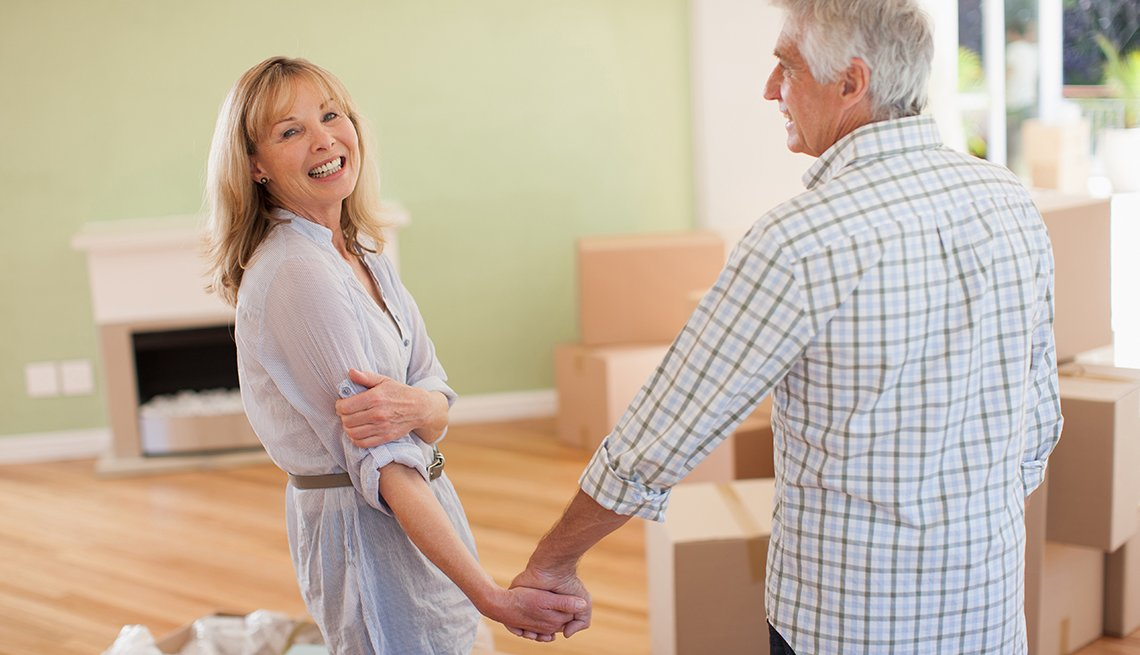 Mature couple, holding hands, happy, new house, Housing, AARP Foundation