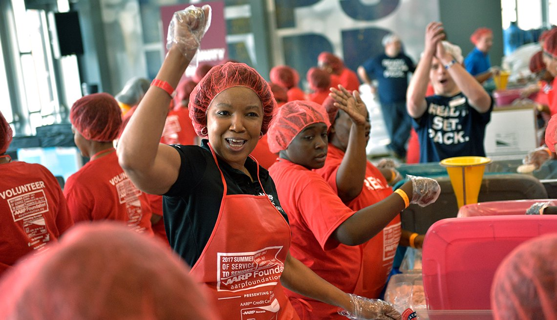 Volunteers, cheering, AARP Meal Pack Challenge, Memphis, AARP Foundation