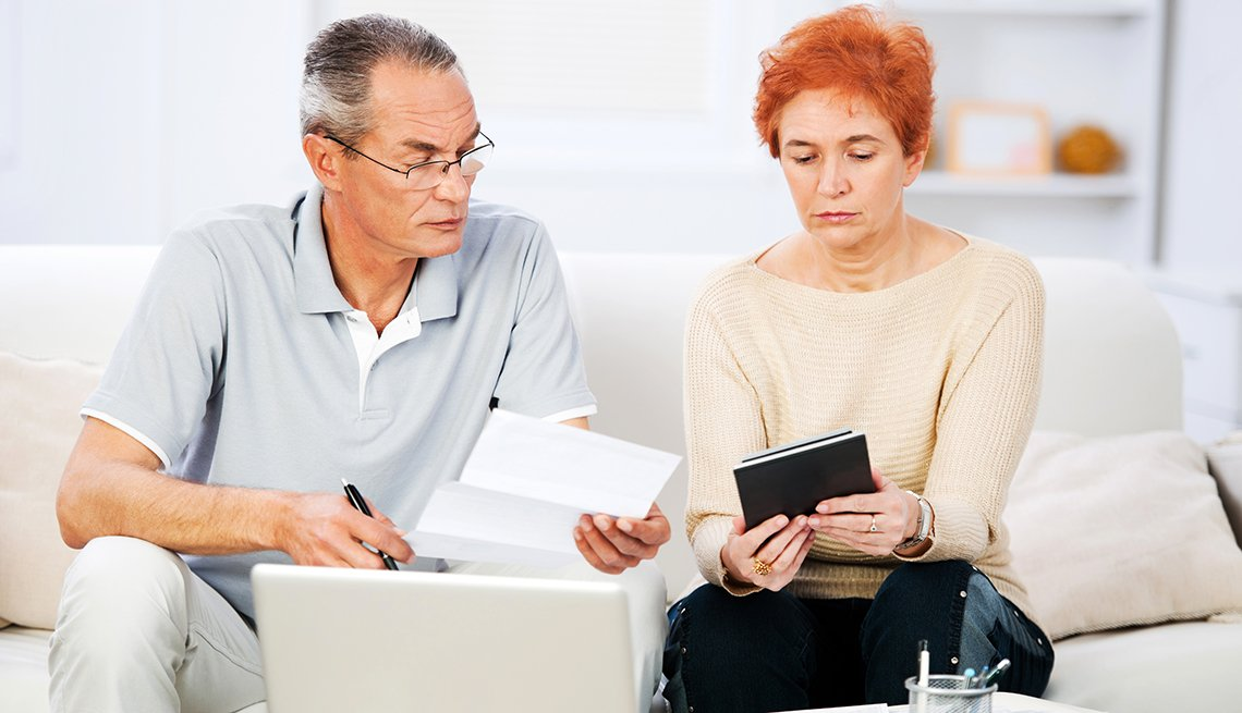 mature couple, reviewing paperwork, Guide to Public Benefits, AARP Foundation, Find Help,