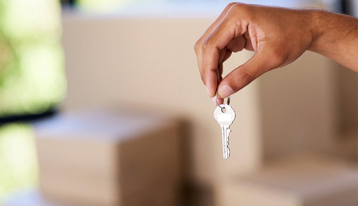 Man holding key, Housing, AARP Foundation Litigation, Legal Advocacy