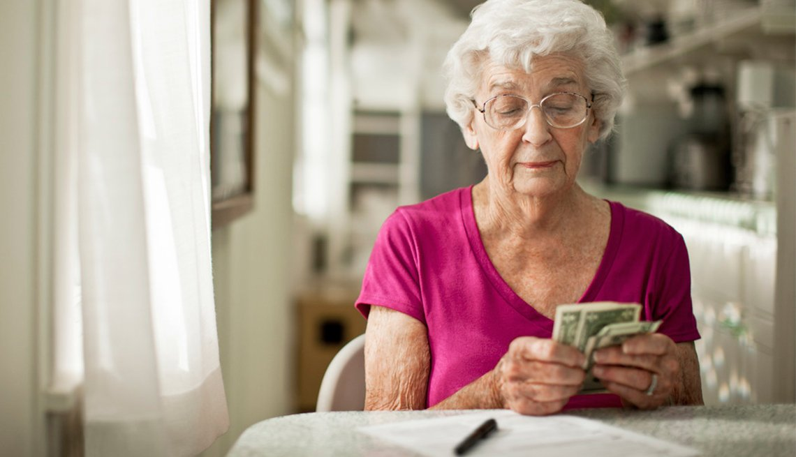 Mature woman counting money, Income, AARP Foundation Litigation, Legal Advocacy