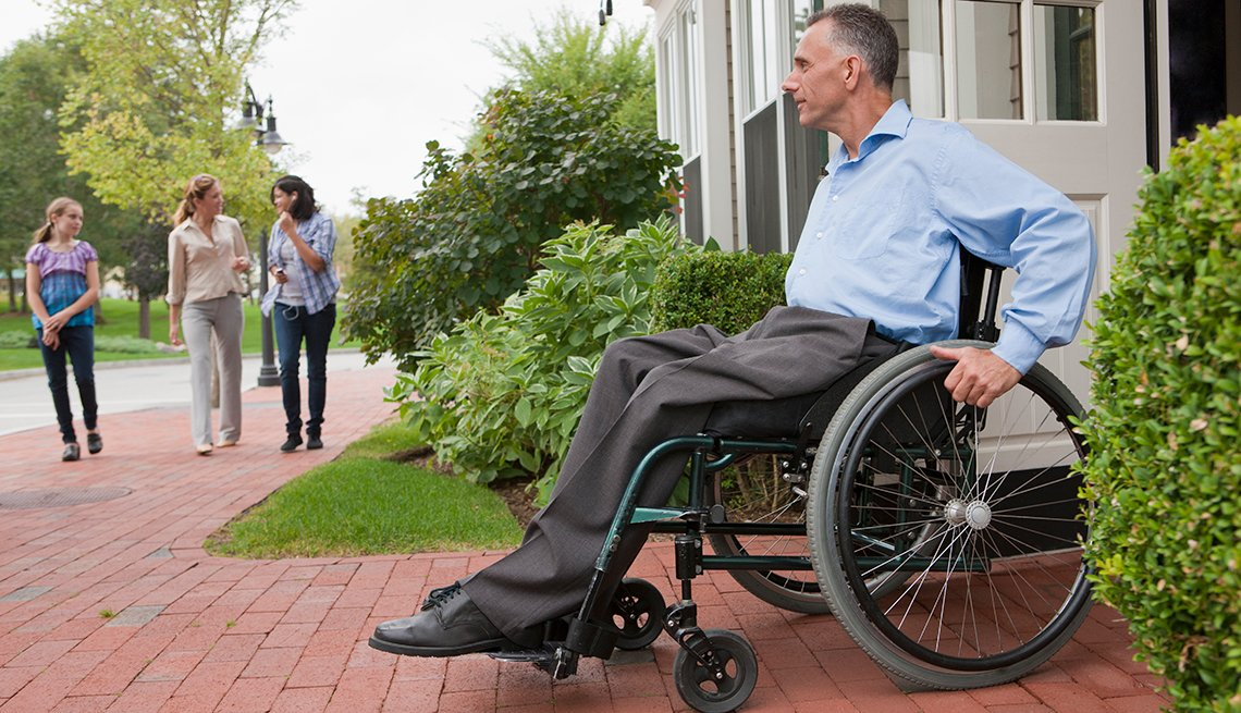 Mature man, wheelchair, exiting house, AARP Foundation, Housing, Our Work