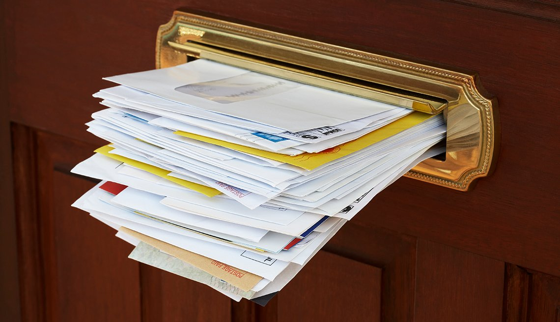 Mail stuffed into door slot, Avoid Foreclosure scams, Housing Solutions Center, AARP Foundation