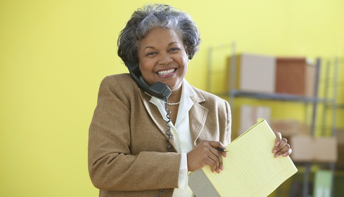 African-American woman, phone, office setting, AARP Foundation, Back to Work 50 plus