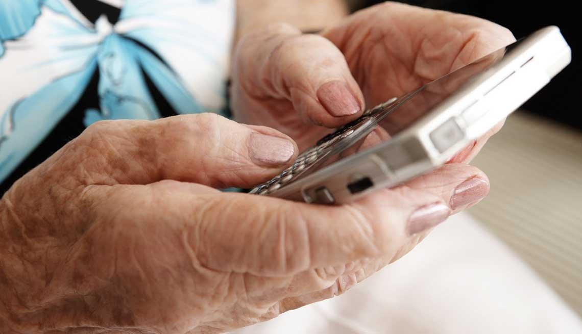 Identifying Fraud, Senior woman, texting, smart phone