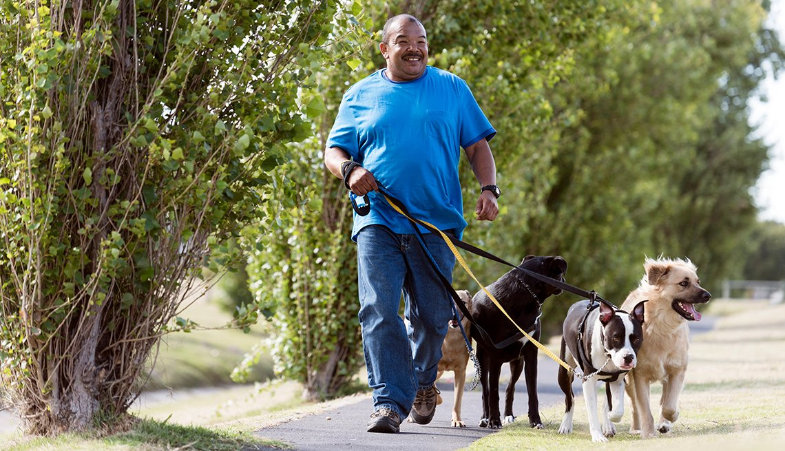 African-American mature male, dogwalker, outdoors, Work for Yourself 50+, AARP Foundation