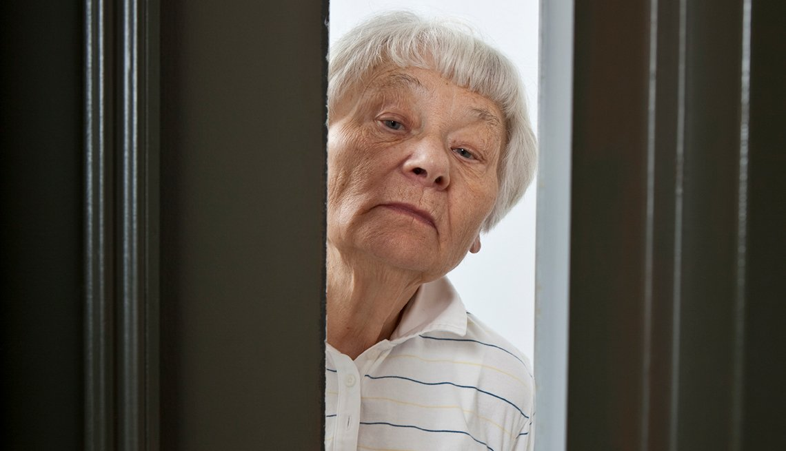 Skeptical woman at door, Refuse Fraud, AARP Foundation, ElderWatch