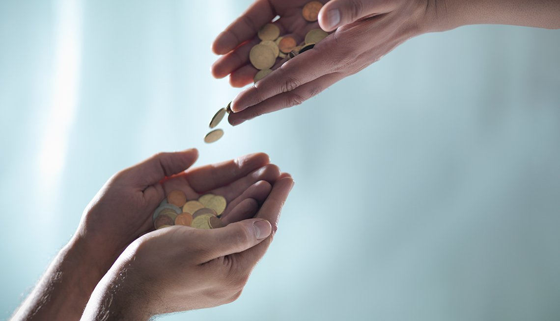 Hands Passing coins, Ways to Give, Donate, AARP Foundation