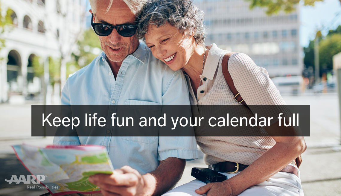 A middle aged caucasian couple look at a map outdoors with text that reads keep life fun and your calendar full.