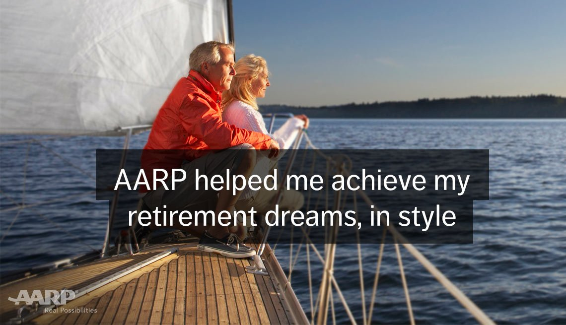 Senior caucasian couple look over water from the deck of a sailboat, A A R P helped me achieve my retirement dreams, in style.