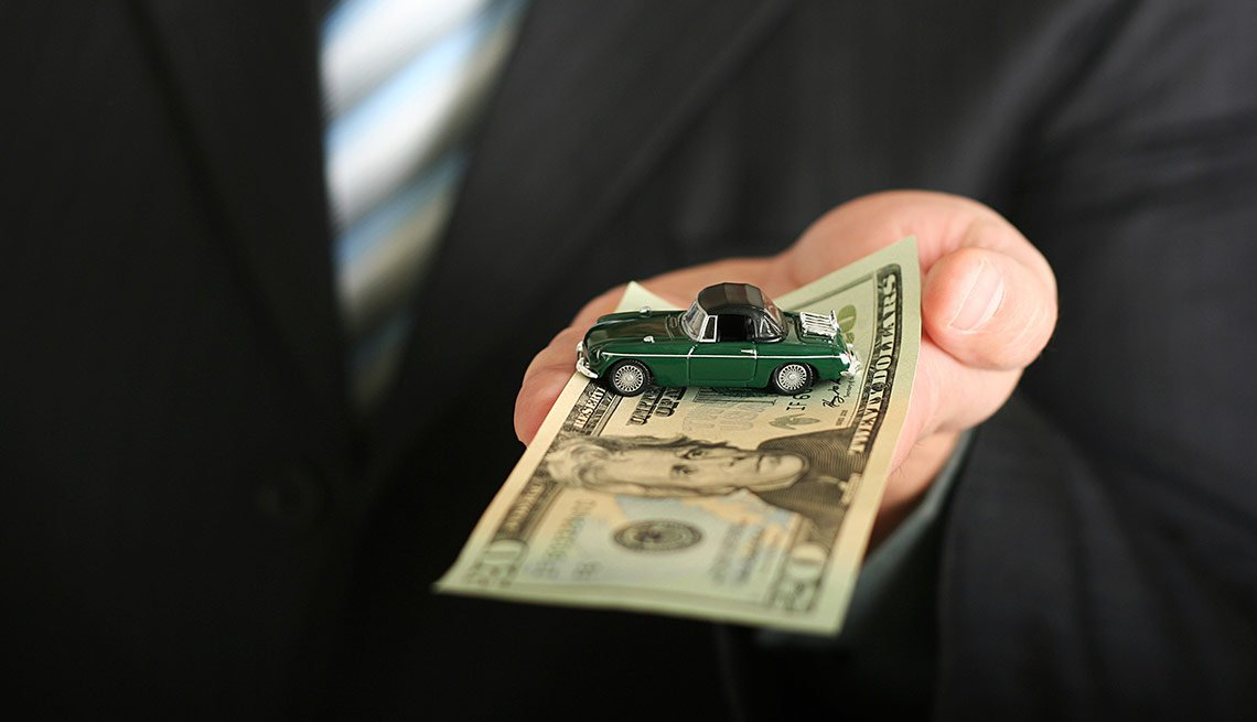 Sales agent offering a car