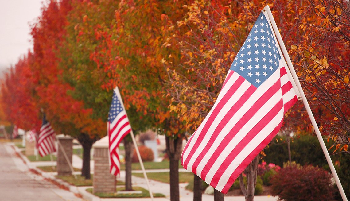 Fall Foliage along Residential Street with American Flags, AARP Driver Safety