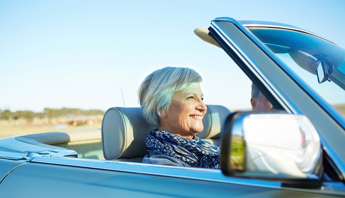 couple driving through the countryside in a convertible, Auto Insurance