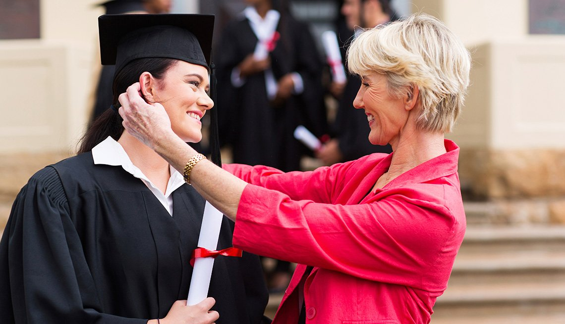 Mother hugging her daughter at graduation ceremony, College Savings