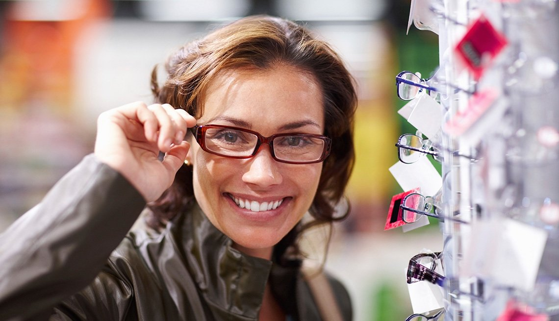 woman in glasses at spectacles store, Vision Discounts