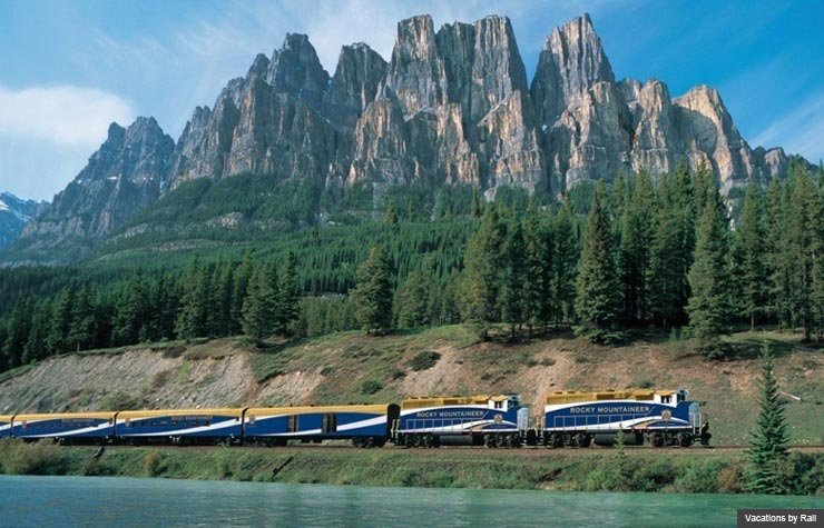 Train passes by mountain, Vacations by Rail (Vacations by Rail)