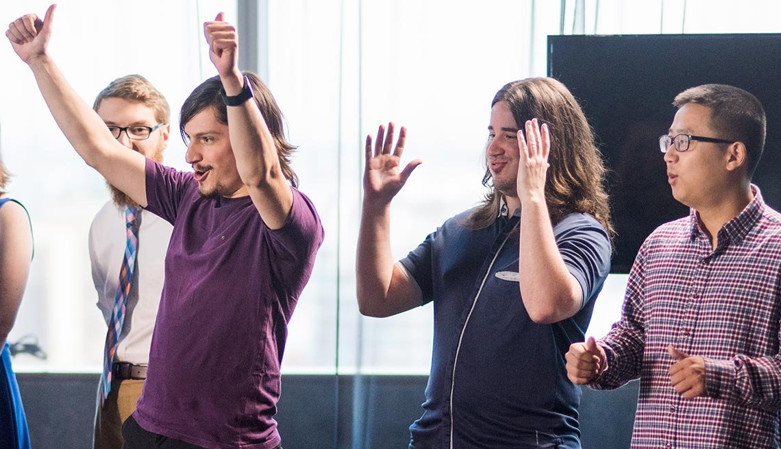 Trainwreck Games teammates Pedro Cori, Alexander Formoso, and Cong Liu, celebrate winning the AARP/ESA Social Connection GameJam