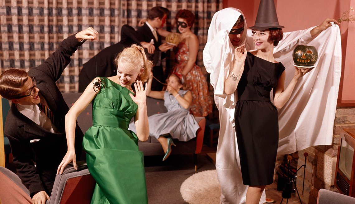 Halloween party with several guests in costume and featuring various Halloween props and accessories, circa 1968