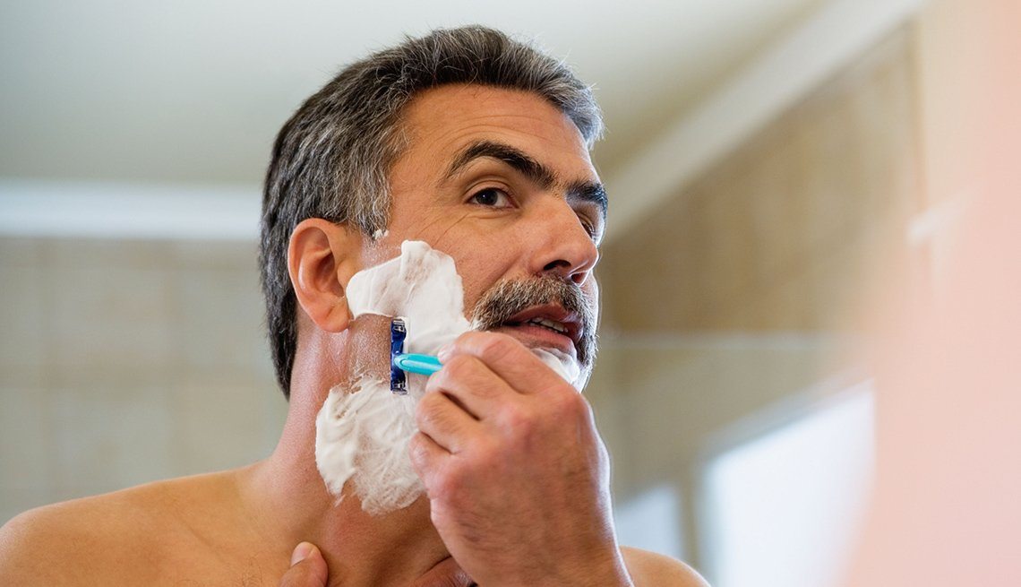 Man Shaves Face In Mirror, Look Younger