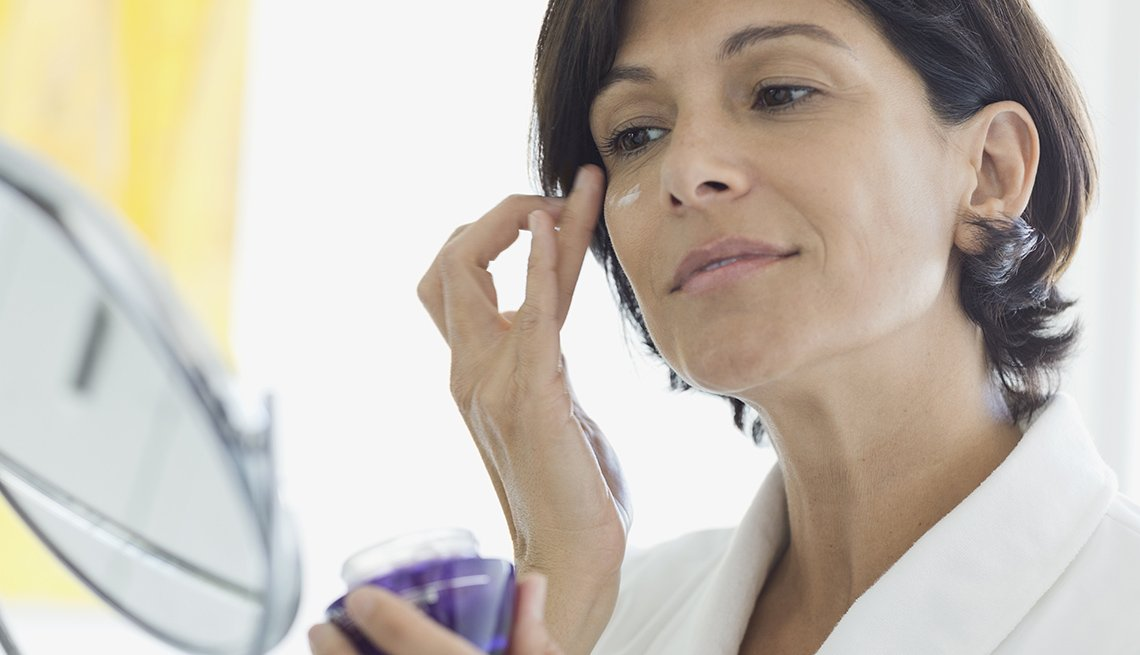 Woman Applying Makeup, Moisturizer, Mirror, Bathroom, Look Younger