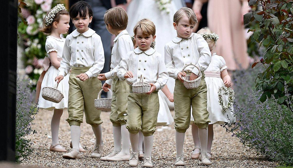 Britain's Prince George, center,  at the wedding of his aunt, Pippa Middleton to James Matthews