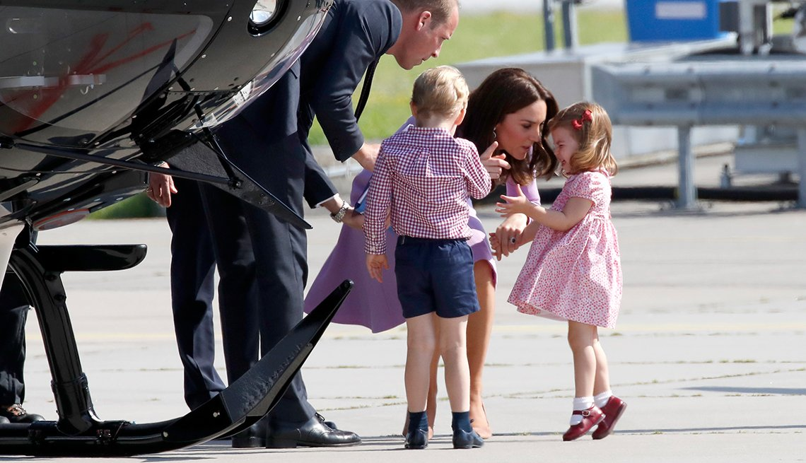 The Duchess of Cambridge talks with Princess Charlotte in Hamburg, Germany
