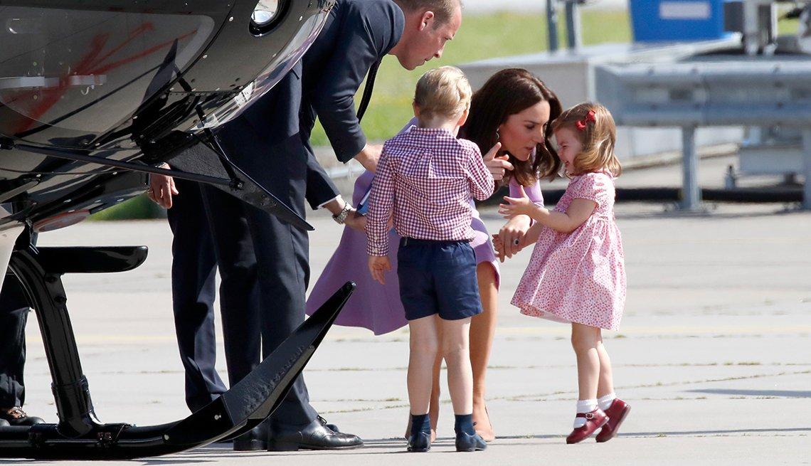 The Duchess of Cambridge talks with Princess Charlotte in Hamburg, Germany
