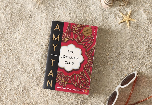 Beach scene with classic book THE JOY LUCK CLUB perched up in the sand, Power of 50 Summer Books