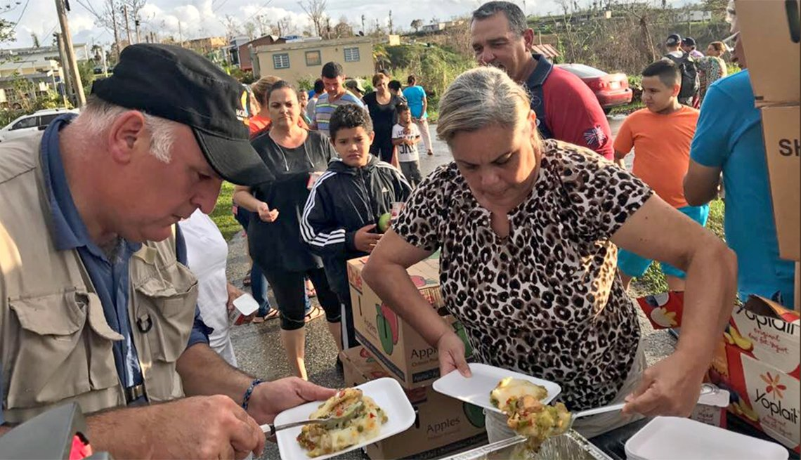 Chef Jose Andres serves food in a mountaintop town outside of Utuabo, Puerto Rico