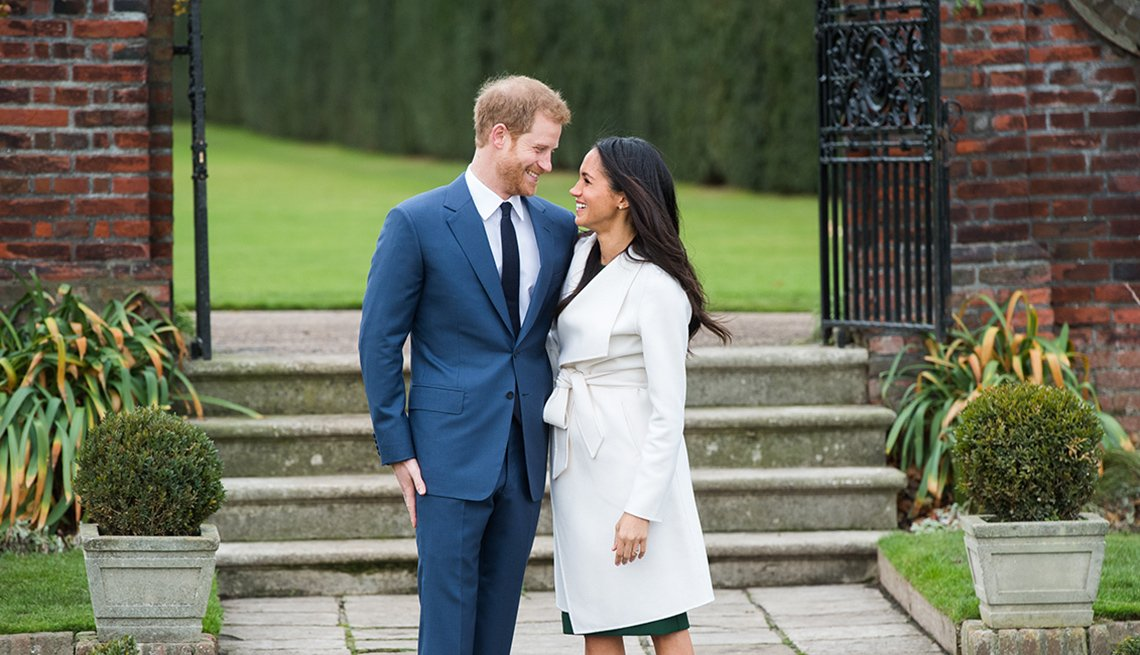 Prince Harry and Meghan Markle in the Sunken Garden at Kensington Palace, London, after the announcement of their engagement
