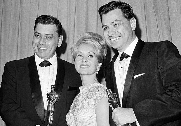 Debbie Reynolds poses with Academy awards winners for best music Richard M. Sherman, right and Robert Sherman, left, who received the award for Mary Poppins in Santa Monica Calif.
