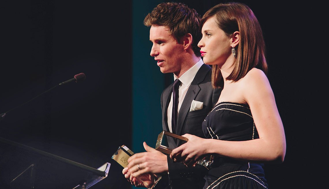 """Eddie Redmayne and Felicity Jones, the stars of the night's Best Picture The Theory of Everything, accepted with thanks to """"everyone we met who suffers from ALS."""