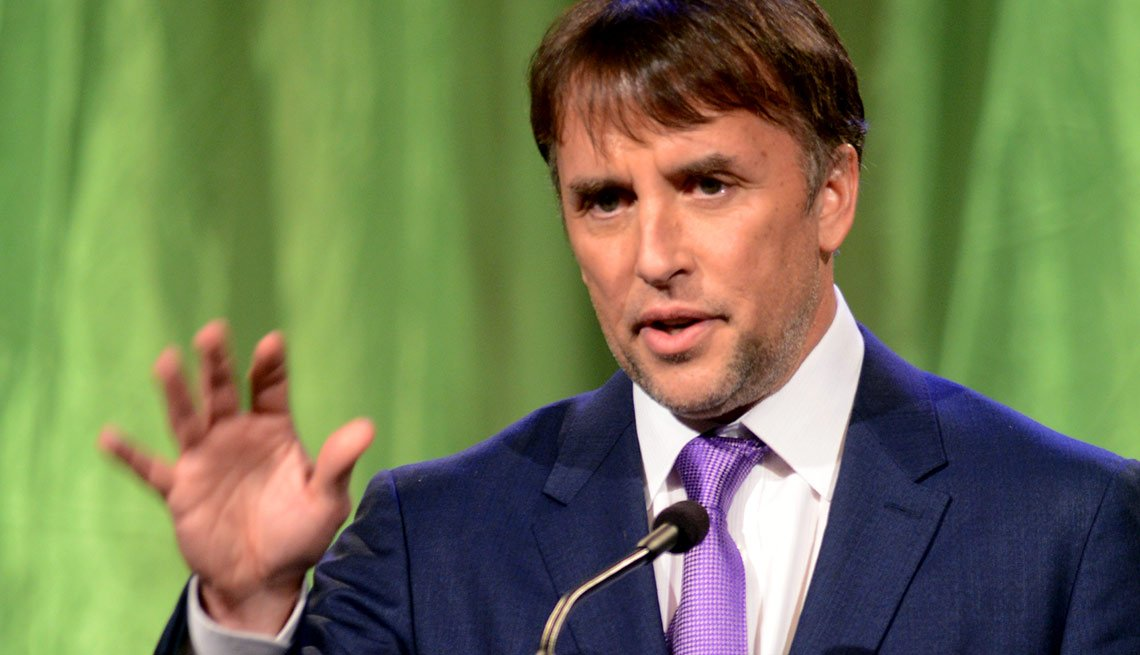 Richard Linklater is seen accepting an award for Best Director for