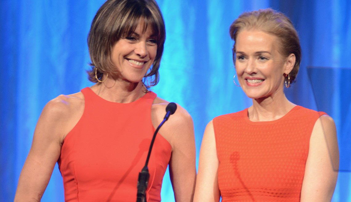 Wendie Malick, left, and Penelope Ann Miller are seen presenting an award for Best Buddy Picture at AARP the Magazine's