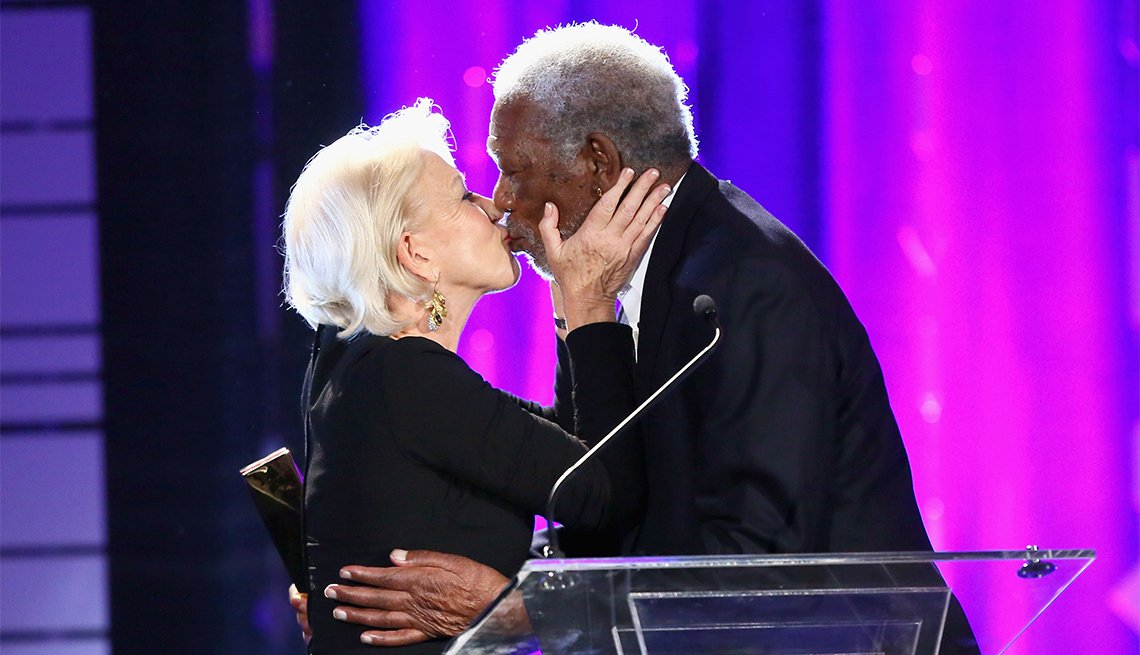 Actor Helen Mirren presents the Career Achievement Award to actor Morgan Freeman