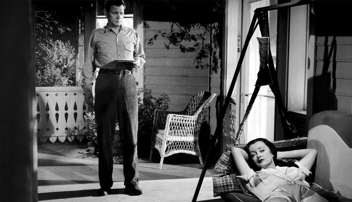 Joesph Cotten and Bette Davis in 'Beyond the Forsest'