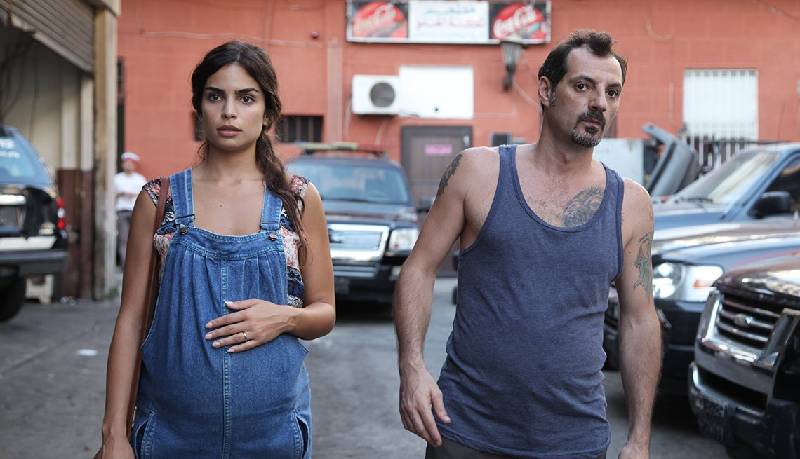 Actors Rita Hayek and Adel Karam in a scene from The Insult, set in a parking lot