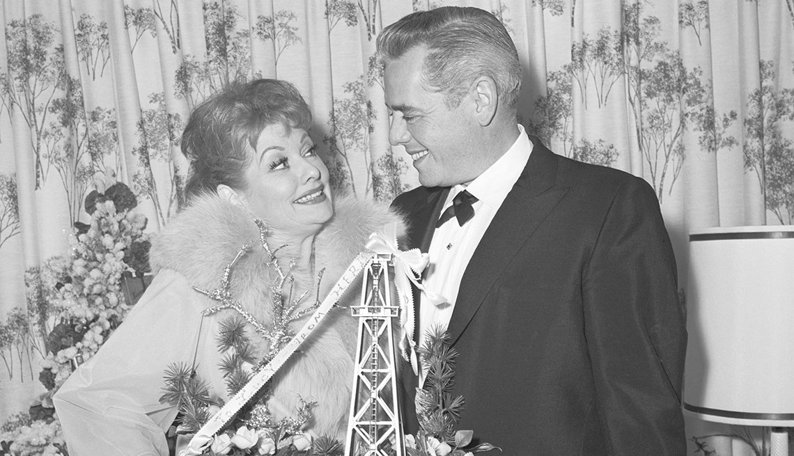 Desi Arnaz congratulates Lucille Ball whom he recently divorced