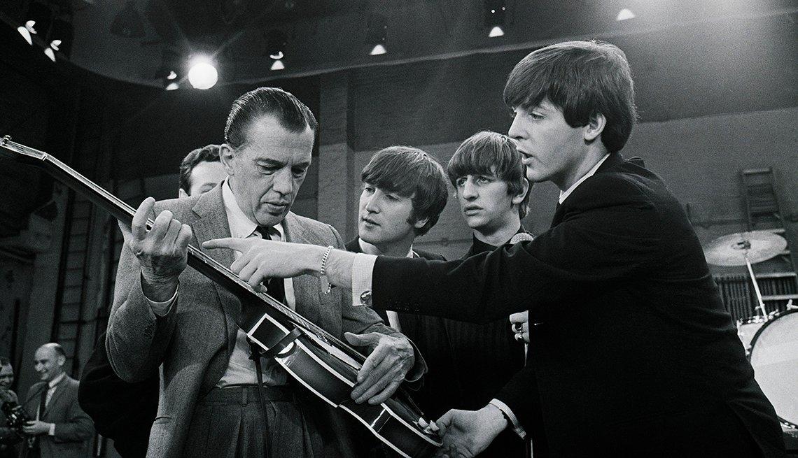 Television Host, Ed Sullivan, Paul McCartney Shows Ed Sullivan His Guitar, John Lennon And Ringo Starr In Background,The Beatles Slideshow