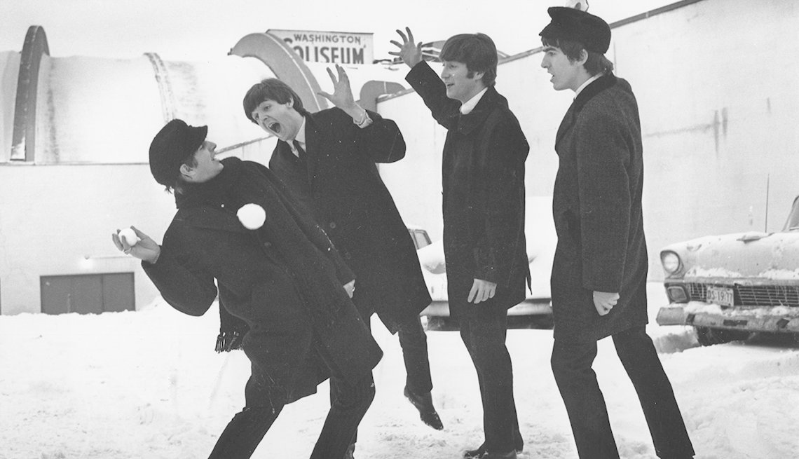 Ringo Starr, Paul McCartney, John Lennon And George Harrison Playing In The Snow At The Airport, USA, The Beatles Slideshow