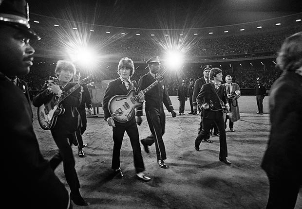 The Beatles walk to the stage before their concert at Candlestick Park in San Francisco in 1966.