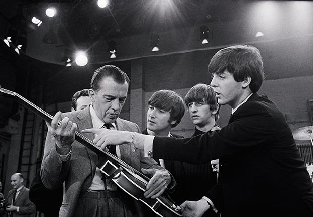 Ed Sullivan receives some guitar lessons from the Beatles Paul McCartney