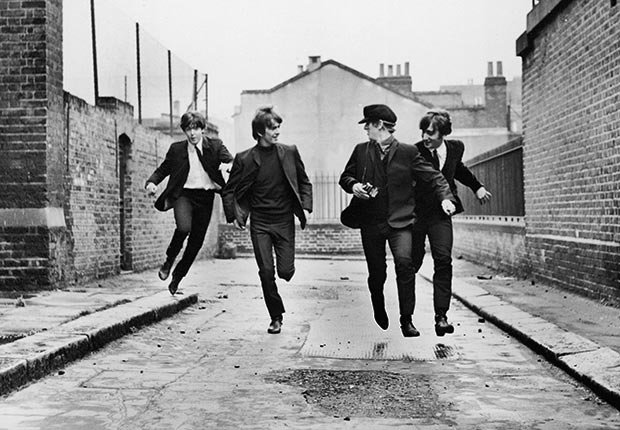 Paul McCartney, George Harrison, Ringo Starr and John Lennon dash down a street in the 1964 Beatles film 'A Hard Day's Night.'