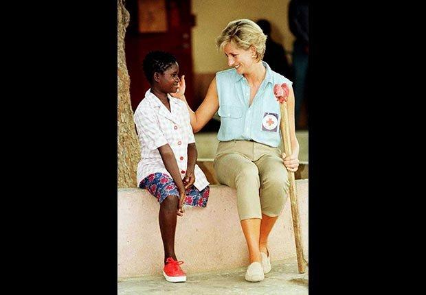 Princess Diana visits a young girl at an orthopedic workshop in Angola, January 1997. (Ian Jones/Zuma Press/Newscom)